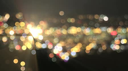 depositphotos 31822983-stock-video-defocused-city-lights-with-moving